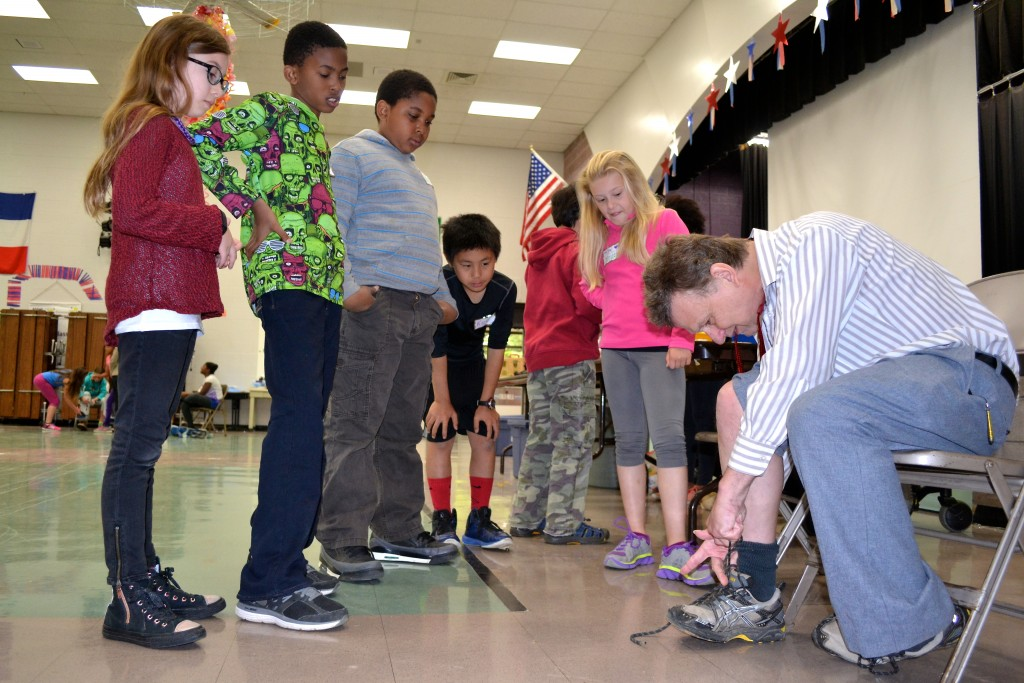 Chris   , who has cerebral palsy, shows the kids how he's able to tie his shoe. Photos by Jo Mathis
