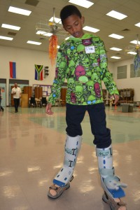 Isaac gets a feel for what it would be like to have prosthetic legs.