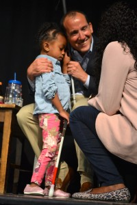 Michigan Supreme Court Justice Richard Bernstein greets Jennifer Joseph and her daughter, Khara, who is nearly four years old and attends Ann Arbor Preschool.
