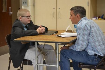 Adam Ruff meets with Google's John Kelley on Portfolio Day. Photos by Jo Mathis.