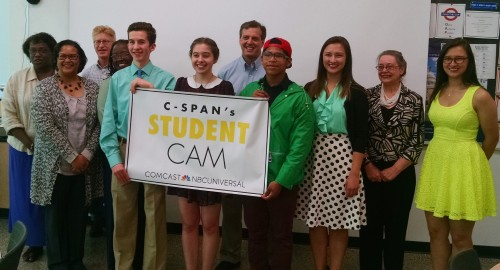 Documentary filmmakers Eli Kirshner, Arden Seigel, and Ricardo Moreno celebrate their film with some of the experts interviewed in the film and representatives from Skyline High School, Comcast, and C-SPAN.