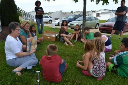 """Lakewood media specialist Eileen Thomas begins """"Art with a Story"""" by reading aloud to the kids."""