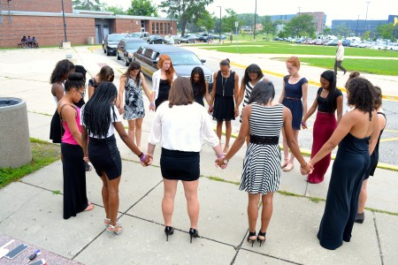 Current and former members of the track and field team gather for a moment of silence in honor of Bryan Westfield.