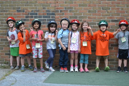 Children don helmets for a tour of the child-sized Safety Town.