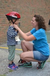 Jessica Cruz adjusts a helmet.