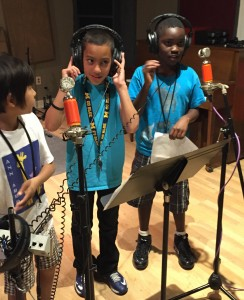 Students recording their raps in the sound studio at the Neutral Zone
