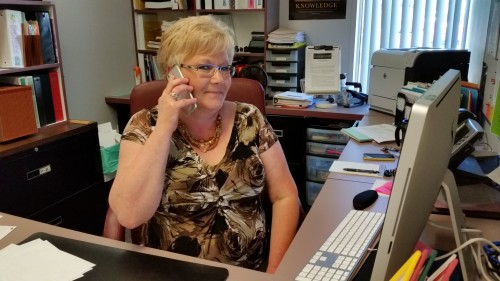 Rhonda Goodman is the friendly voice of AAPS' new Back to School helpline. She is assisted by Ann Judge and Aileen Samson.