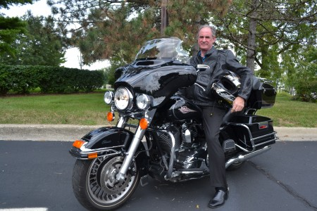 MEA Secretary-Treasurer Rick Trainer takes off on his Harley.