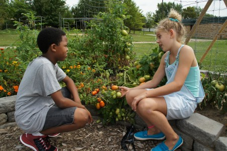 Students Sebastian and Audry, in the Lawton garden. Photo by
