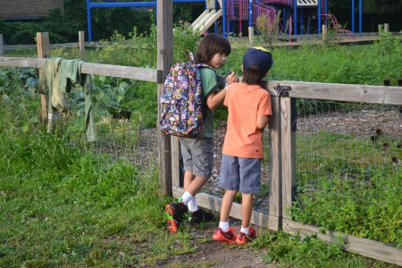 These brothers check out how much the Burns Park garden grew over the summer.