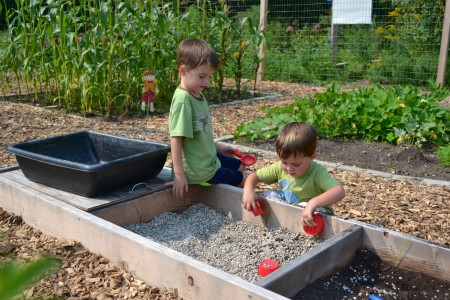 Dicken first grader Cooper and his little brother, Noah, 3, enjoy exploring the Dicken PLANT organic garden.