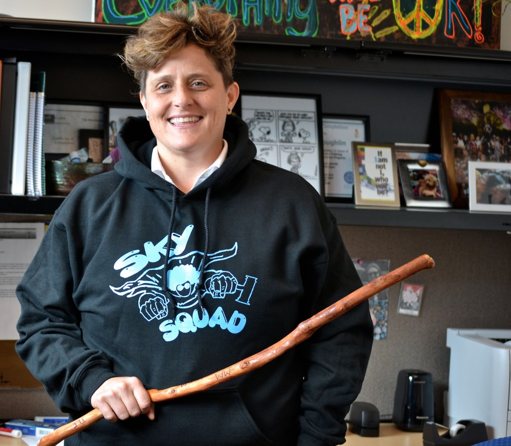 Skyline counselor Amy holds the talking stick used during circle discussions.