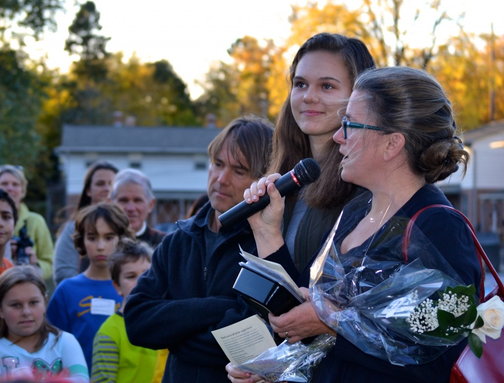 Stephen's mother, Kim, thanks the crowd. Beside her are Stephen's father, Will, and sister, Alexa.