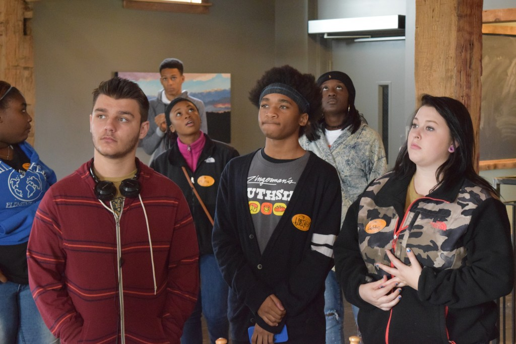 Pathways students tour the reconstructed barn that serves as event space at Cornman Farms in Dexter.