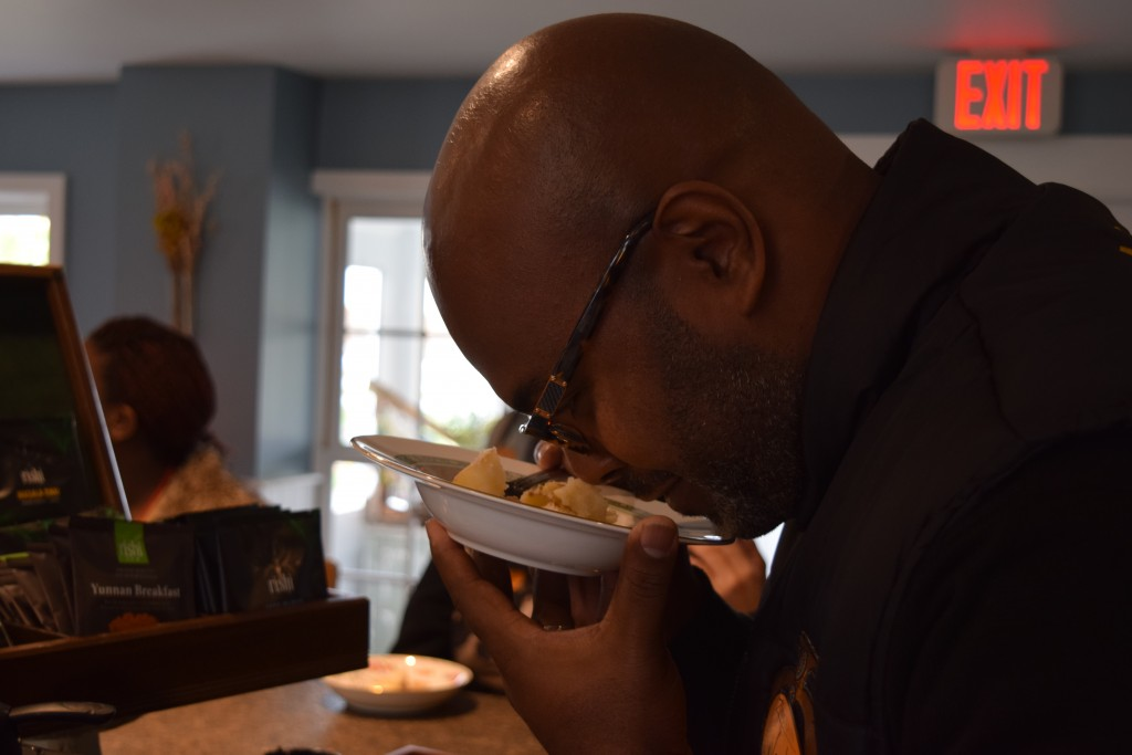 Pathways Principal Tyrone Weeks learns about the proper way to taste food by getting his nose in a bowl of mashed potatoes.