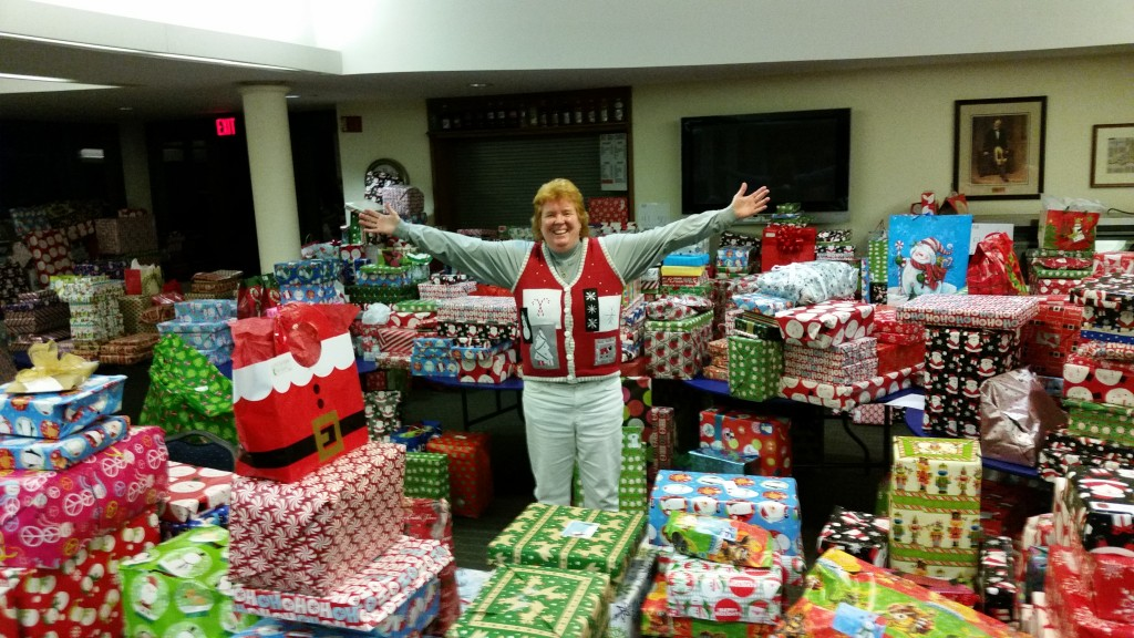 Magic of Christmas- Adoopt a Family Foundation Chair Debbie Williams-Hoak and some of the presents given to children last year. Photo courtesy of the Magic of Christmas.
