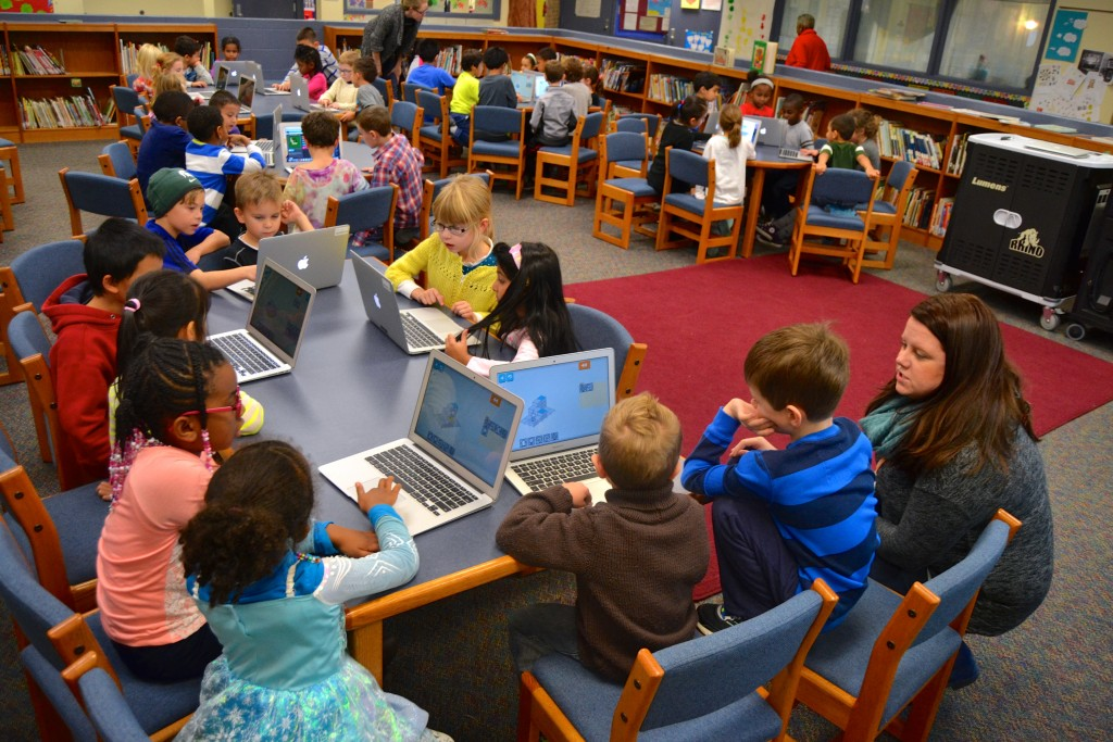 Students learn to code in the Bryant media center Wednesday.