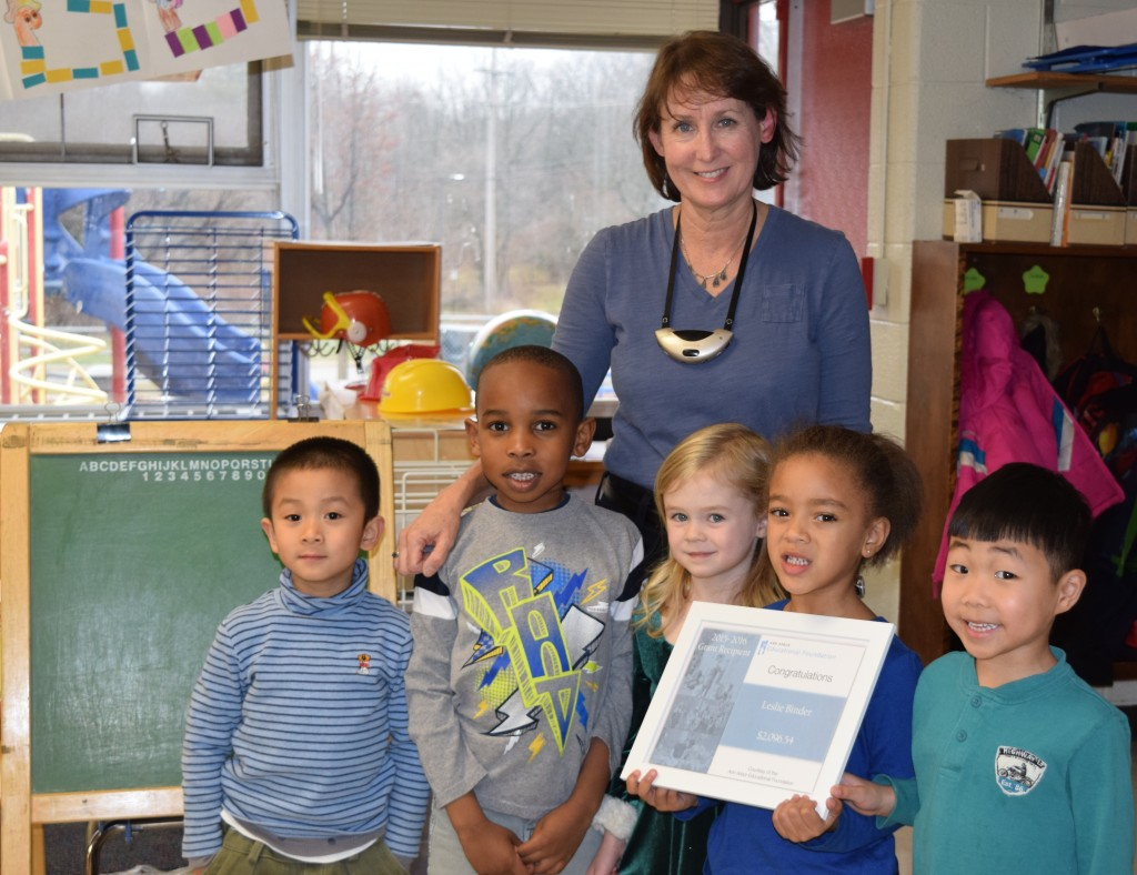 Allen Elementary kindergarten teacher Leslie Binder and some of her students celebrate an Ann Arbor Public Schools Educational Foundation grant that will provide kindergarten readiness bags for next year's kindergarten class.