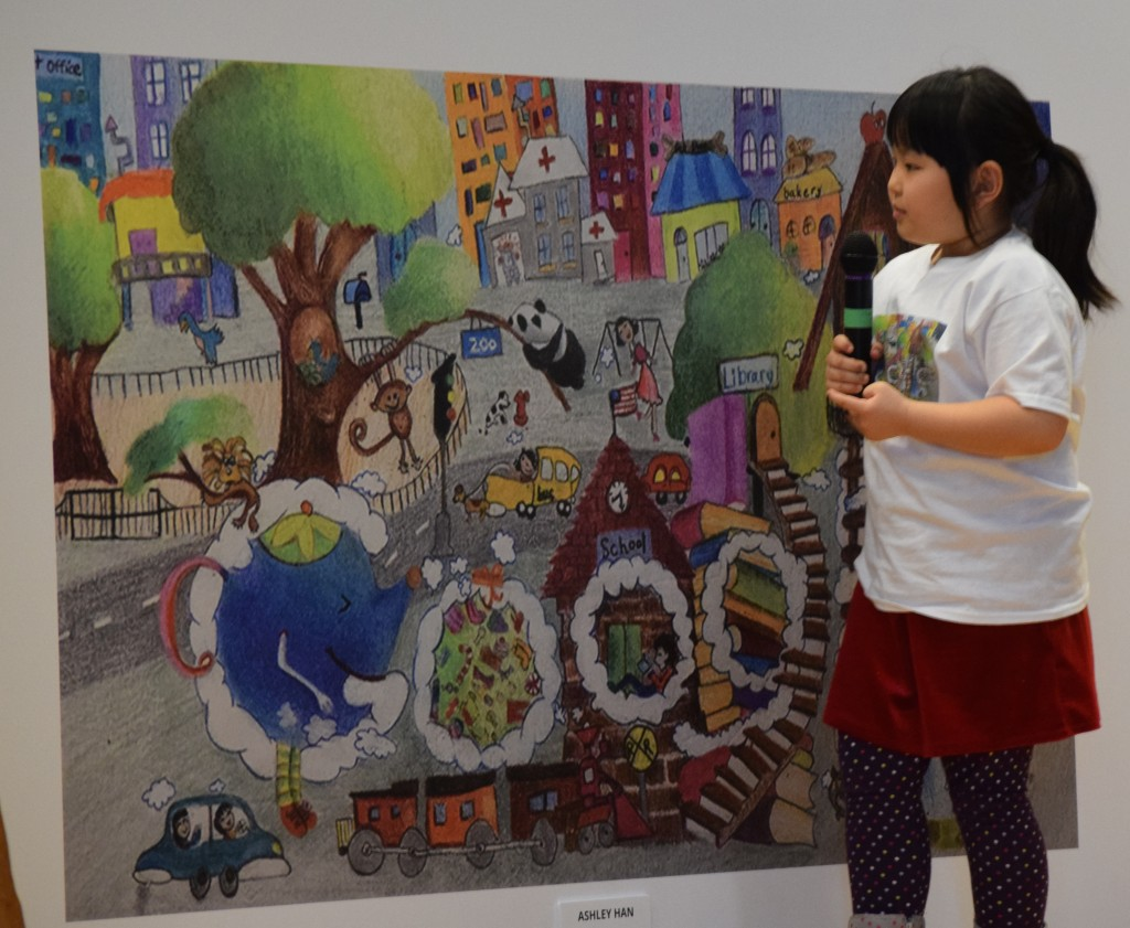 "Ashley Han talks about her Doodle 4 Google contest entry, ""Happiness, You and Me"" at an assembly at Logan Elementary."