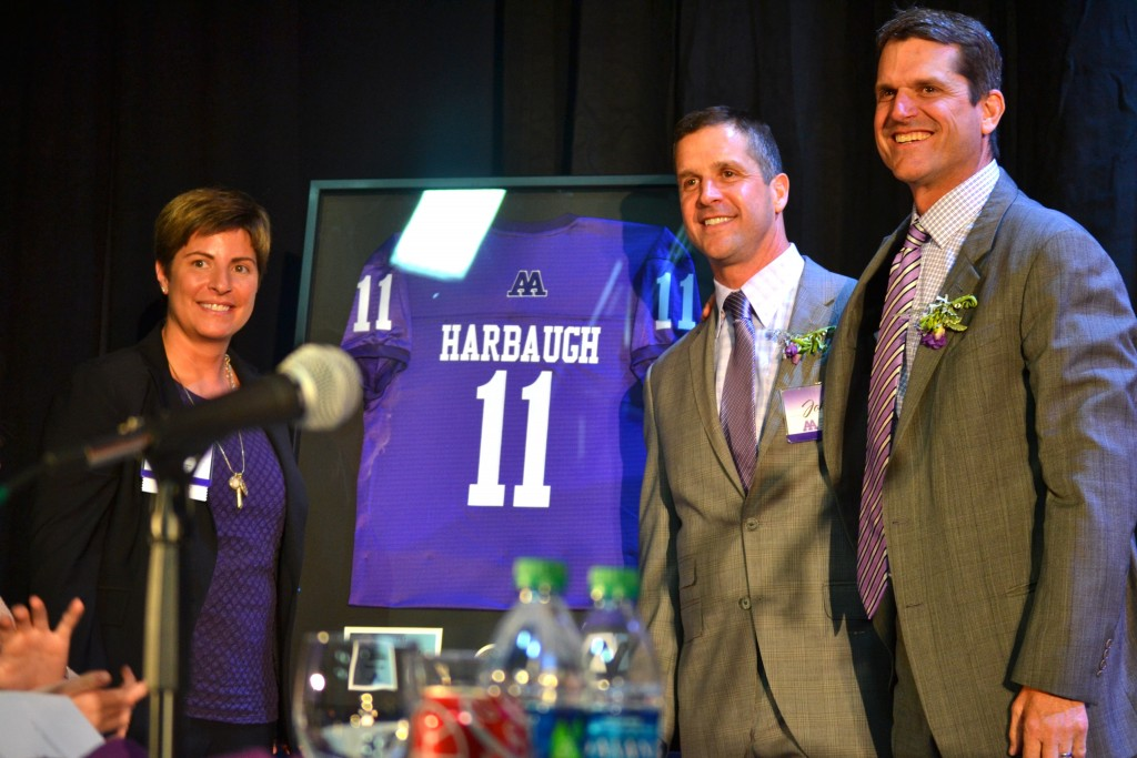 Pioneer AD Eve Claar, and the Harbaughs