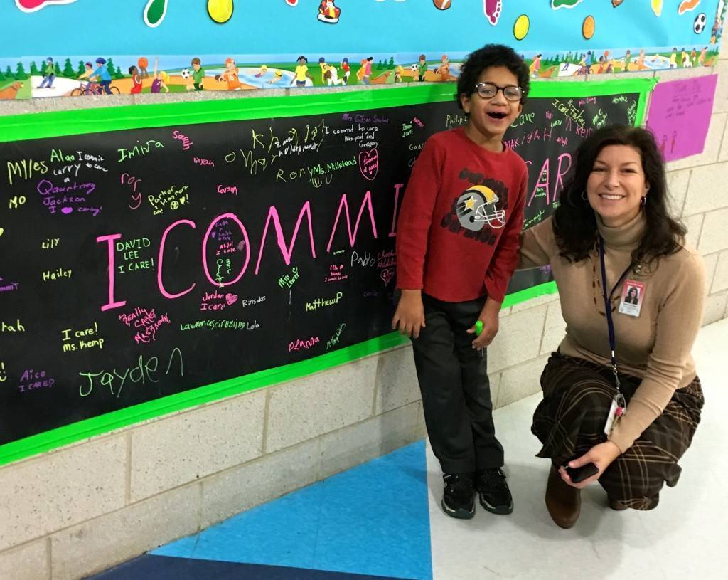 """Dawn Linden with one of my students in front of the banner, he gave her a pin for """"being nice to everyone"""", and she signed the banner. It was a sweet moment, and I thought I'd share the end result also."""