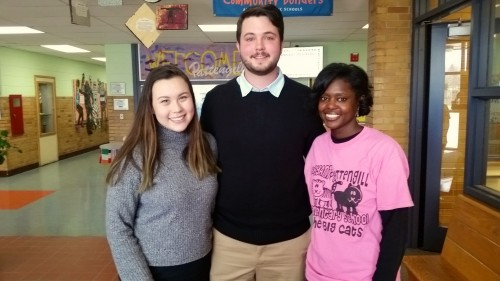 Melita Alston poses with U-M students Daniel Stuhldreher and Diana Curtis, who talked to third graders recently about college.