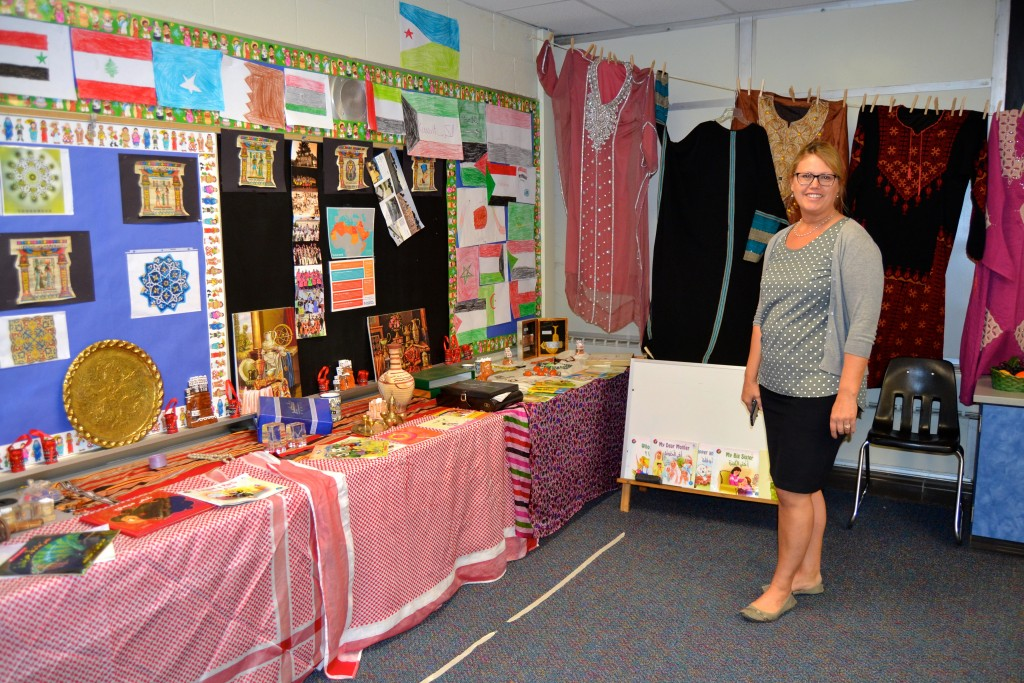 Principal Kerry Beal stands in the world language-Arabic room.