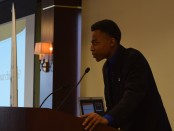 Skyline senior Charles Graham speaking at a podium.