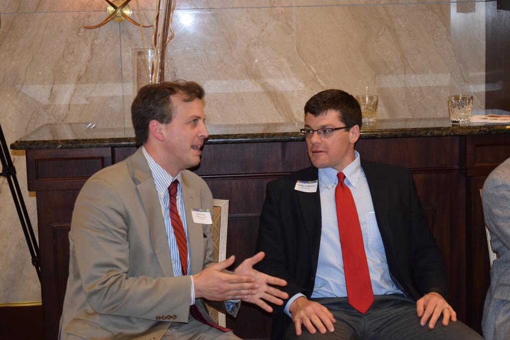 State Representative Jeff Irwin and Andy LaBarre of the Ann Arbor Ypsilanti Regional Chamber chat at the State of the Schools event.
