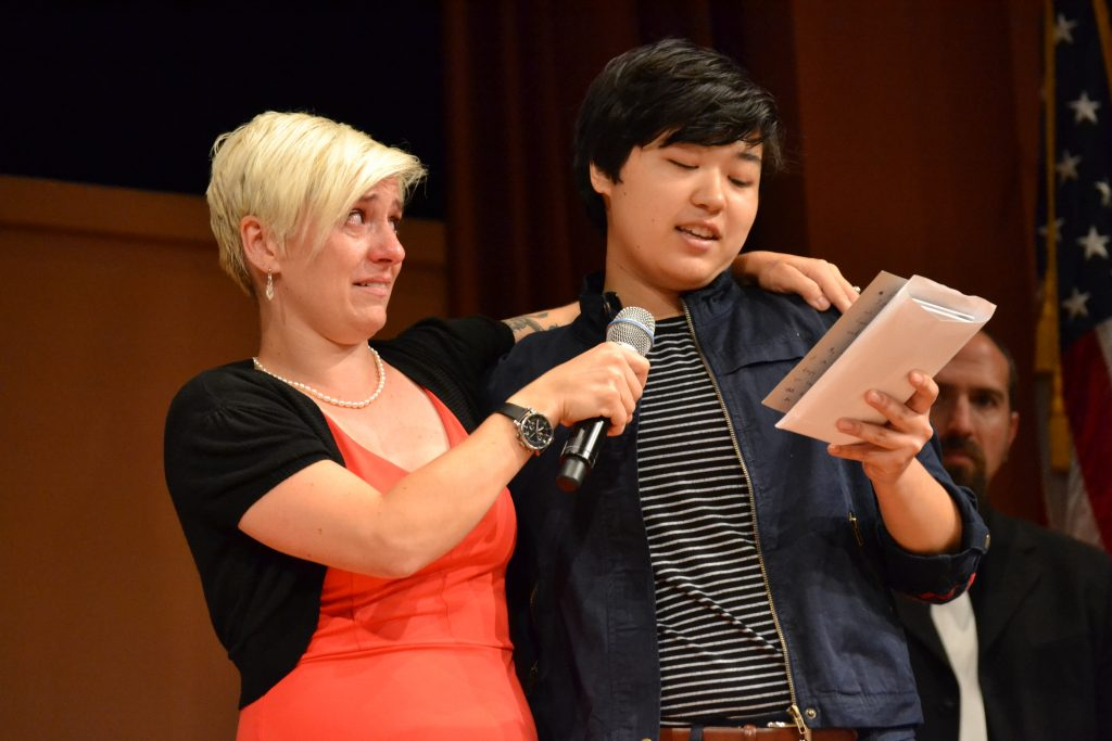 Forum leader Chloe Root holds back tears as Sophia Camp thanks her for her support. Photo by Jo Mathis.