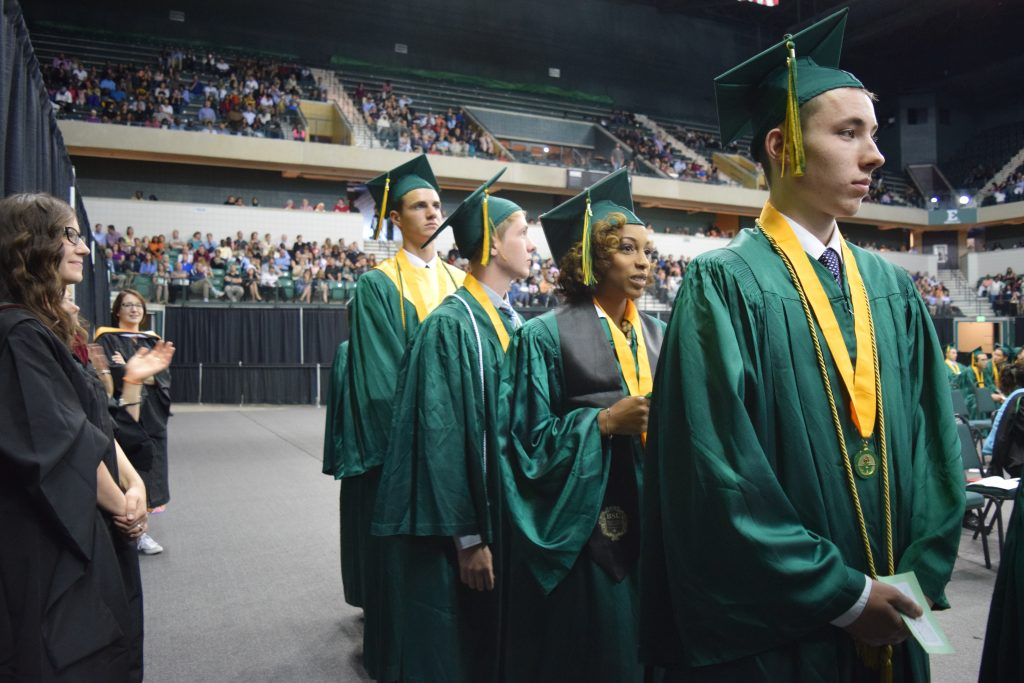 The 2016 Huron High School graduates line up to accept their diplomas. Photo by Jo Mathis.