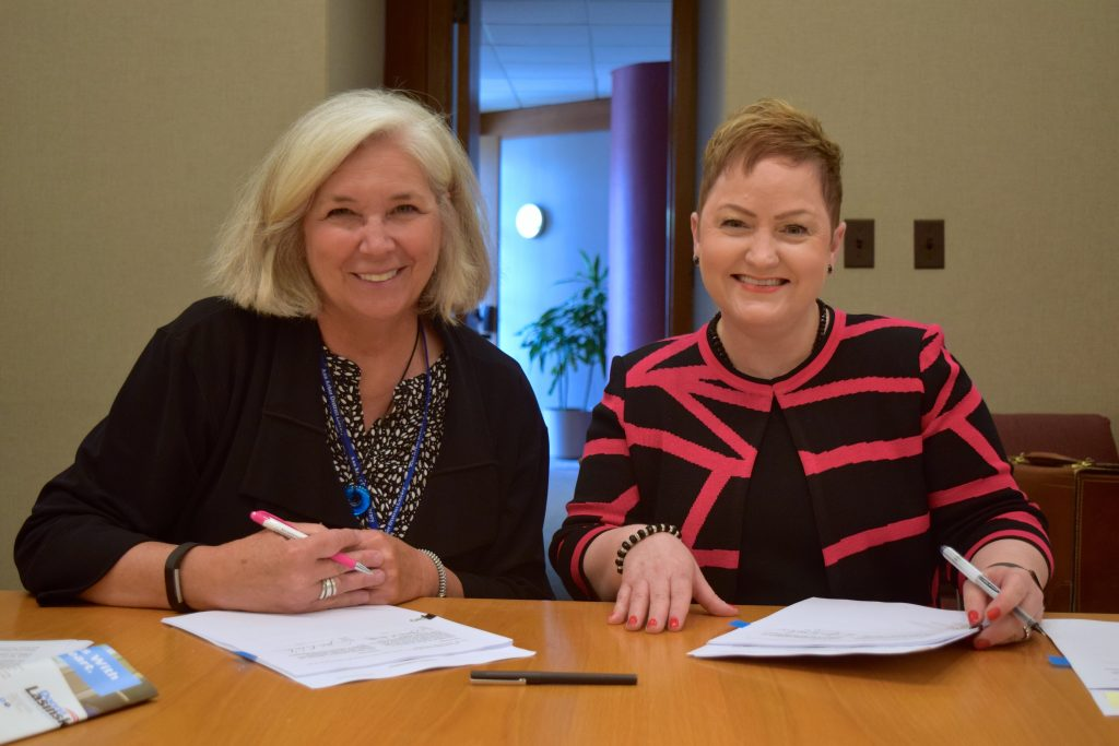 AADL Director Josie Parker and AAPS Superintendent Jeanice Swift sign the agreement June 20, 2016.