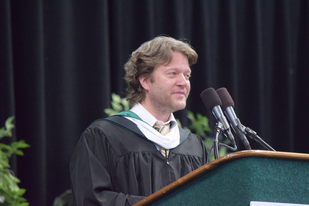 World Language Teacher Tyler Vess delivers the keynote address at Pioneer High School's 2016 Commencement Ceremony.
