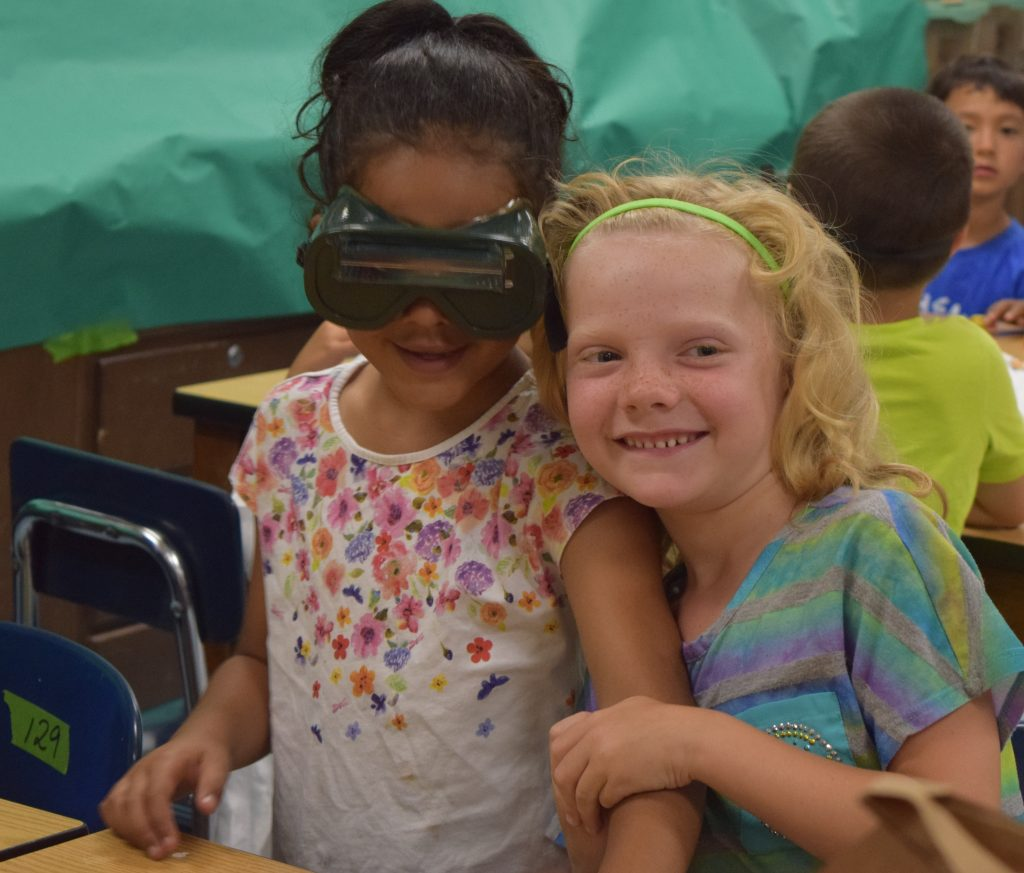 """Students in """"A Wealth of Health"""" camp learn about there senses by trying to accomplish tasks while wearing inversion classes."""