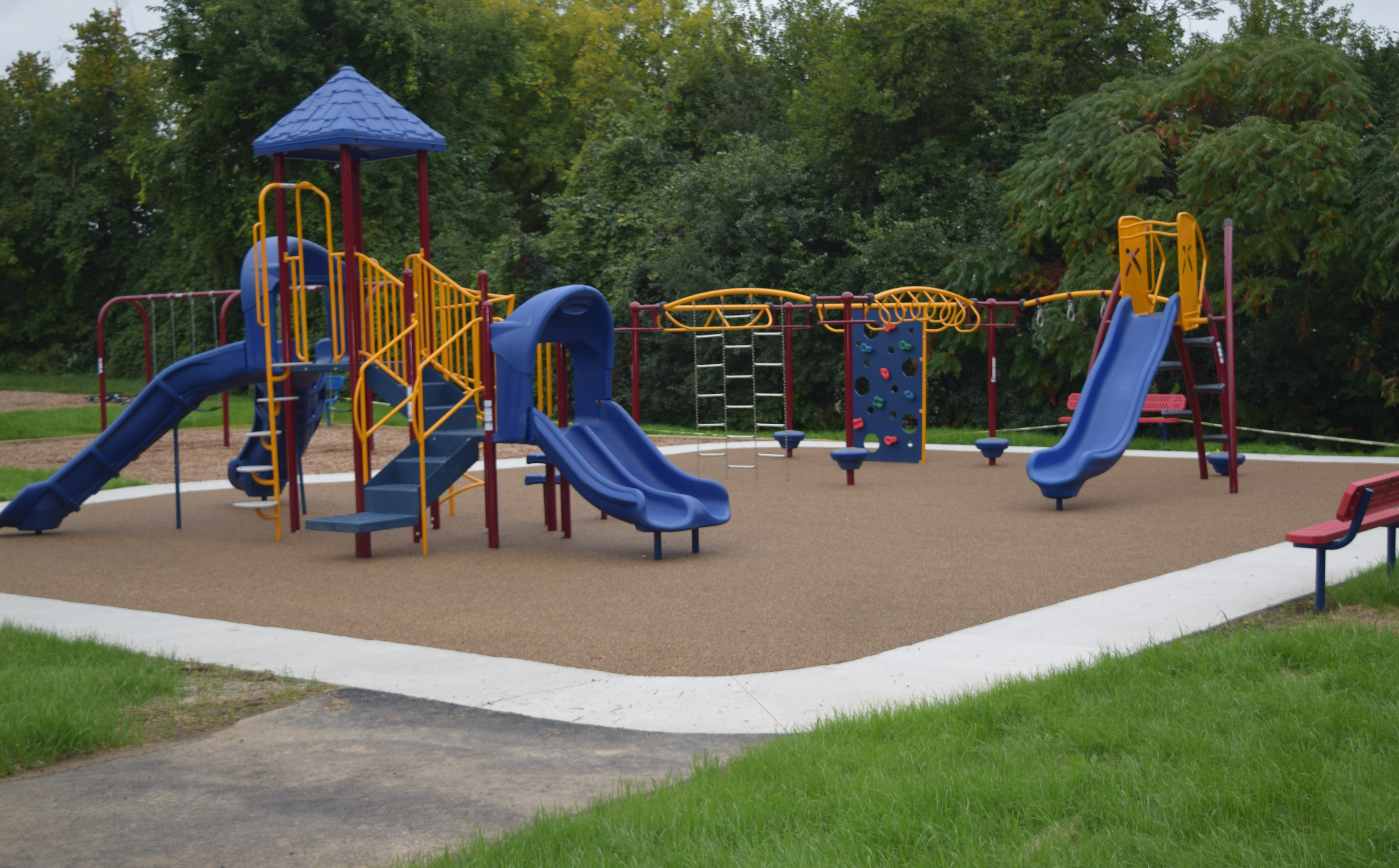 A colorful play structure including slides
