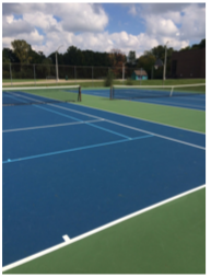 Clague Middle School's tennis court serves as an example of a court in good condition.