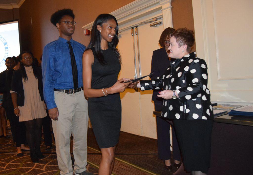 Superintendent Swift congratulates the scholars.