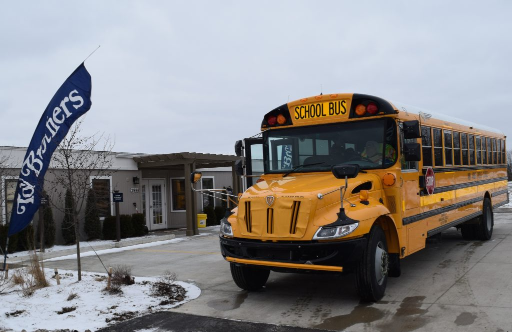 Ann Arbor Public Schools bus in front of Toll Brothers sales office for North Oaks development