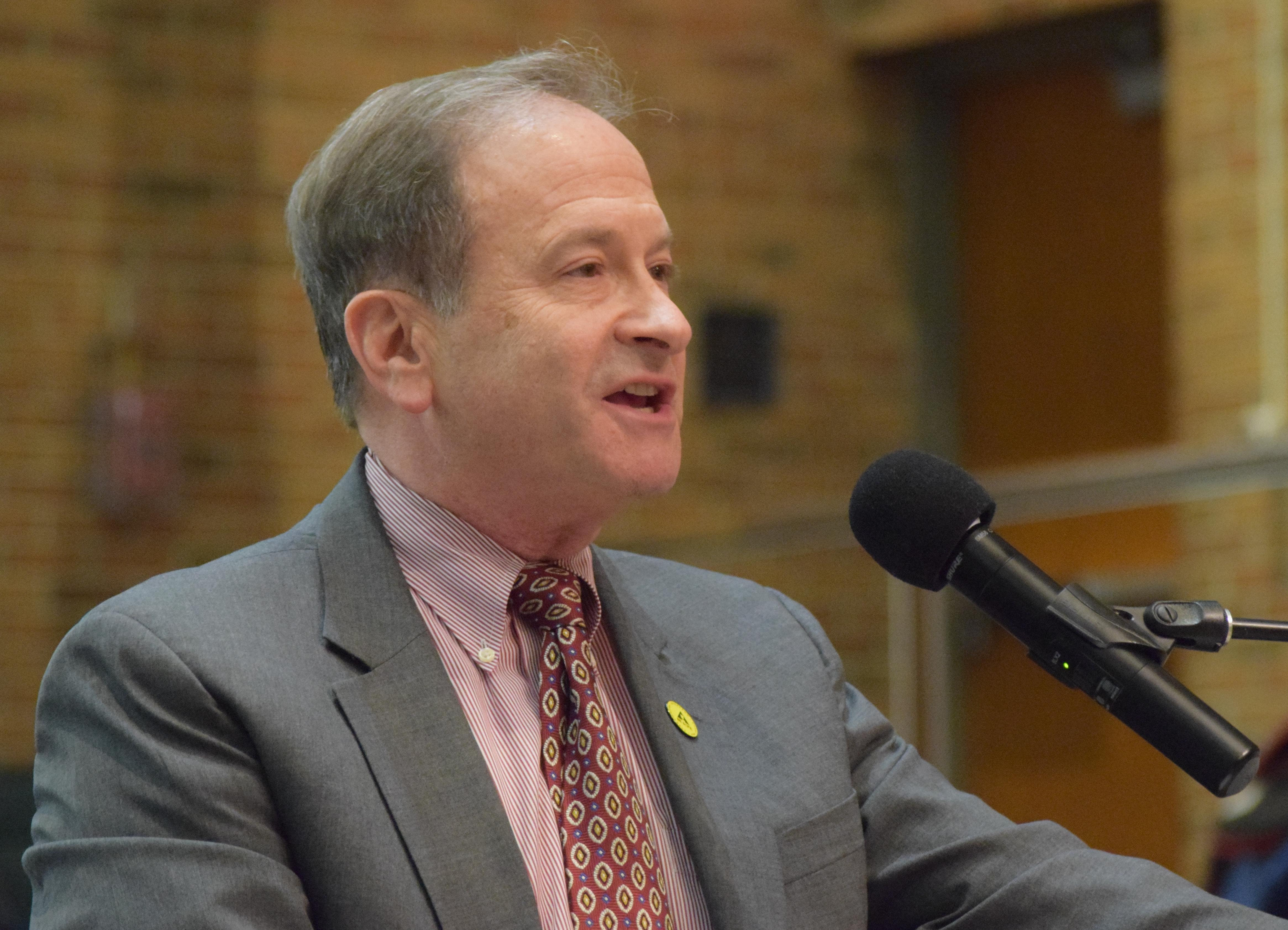 Ann Arbor City Administrator Howard Lazarus speaking at a podium