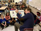 State Representative Adam Zemke reading to a classroom at Pittsfield Elementary