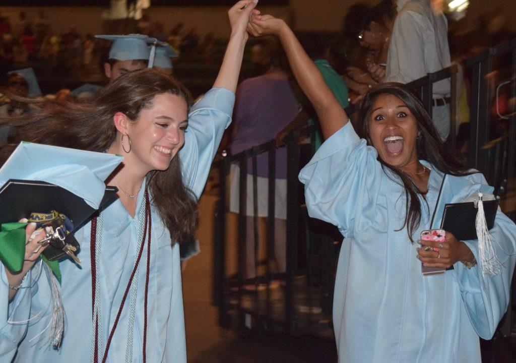 Skyline graduates celebrate receiving their diplomas.