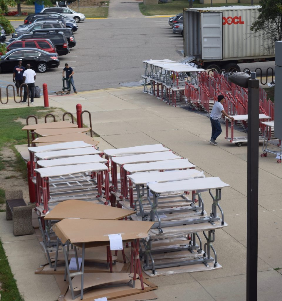 New desks and other classroom furniture stacked up outside of Scarlett Middle School