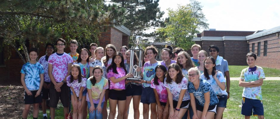 Cello players in Pioneer's Concert Orchestra class celebrate winning Section Pride Day with a trophy