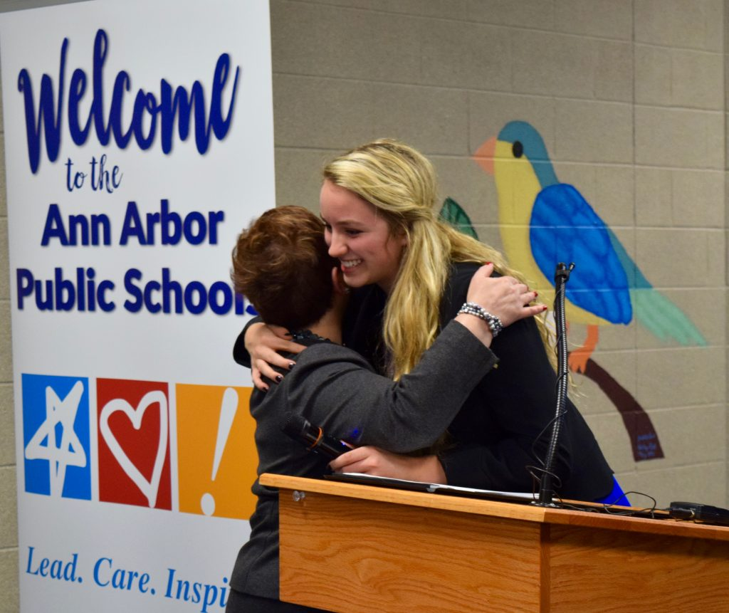 Skyline Senior Olivianah Baugh hugs Superintendent Jeanice Swift