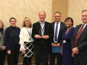 Comsa celebrates the Michigan Human Resource Professional of the Year Award with some of his co-workers