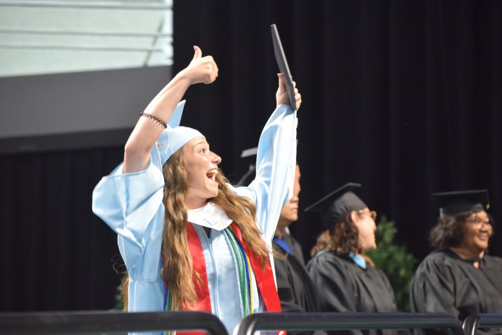 Skyline graduate celebrates receiving her diploma