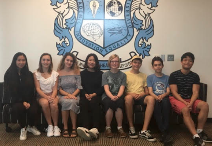 Skyline High's 2019 National Merit Semi-Finalists seating in front of the skyline logo