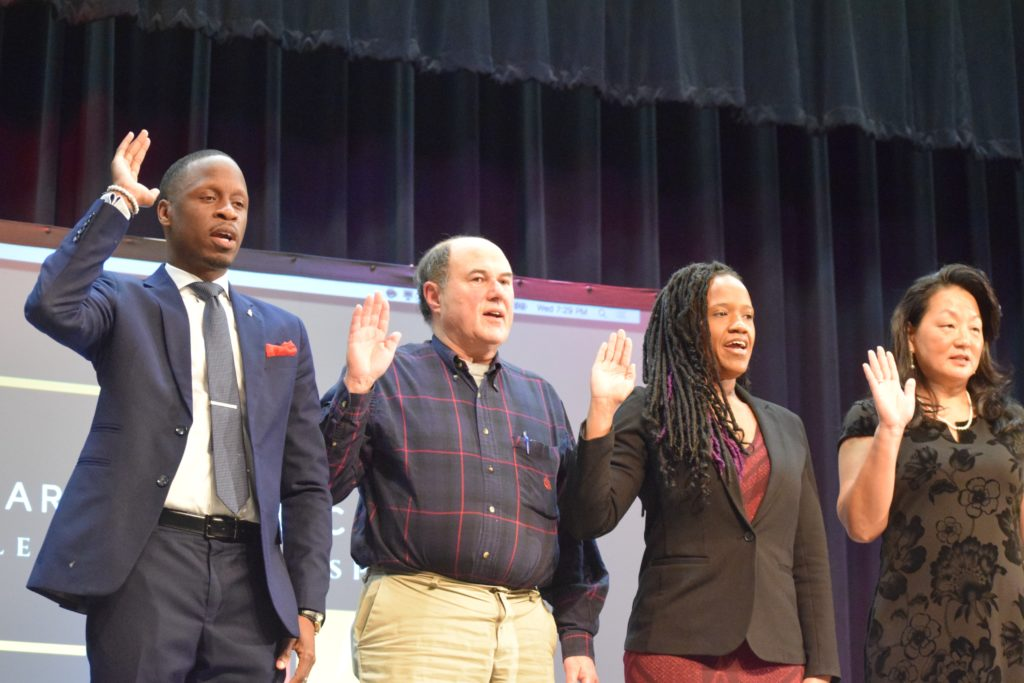 Bryan Johnson, Jeff Gaynor, Harmony Mitchell, and Rebecca Lazarus take the Officers Oath of Office