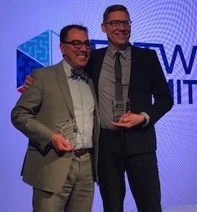 Tom Pachera and Bill Van Loo holding glass trophies