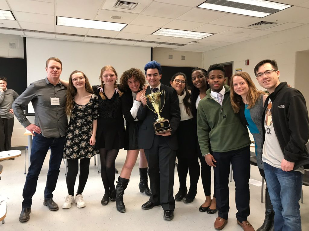 Pioneer's Ethics Bowl Team and their state championship trophy